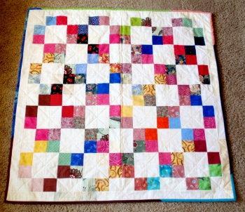 All these four patches were sent by a Sparkle Jane fan. They made a cute quilt, don't you think? Thanks to the donor!